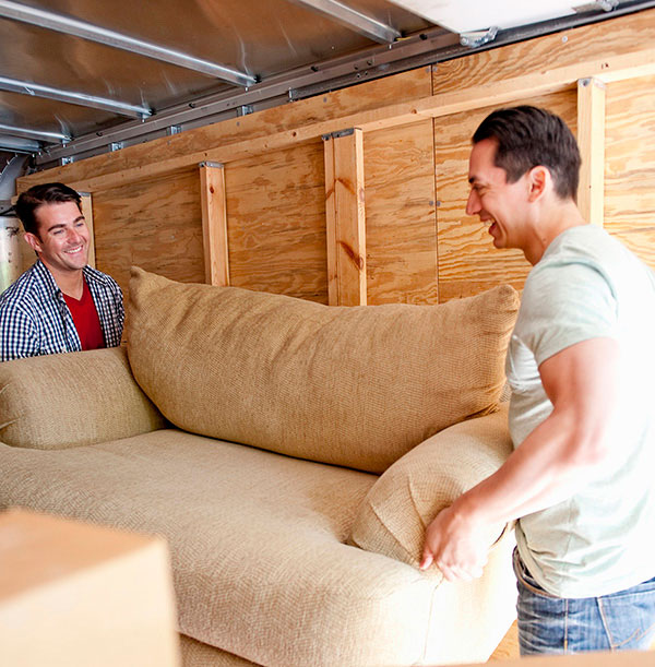 Two men moving a sofa