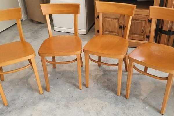 Four IKEA wooden dining chairs