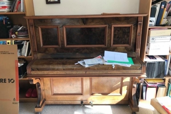 Very old steel framed upright piano